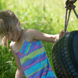 risky play outdoors tyre