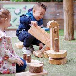 risky play rustic blocks outdoors