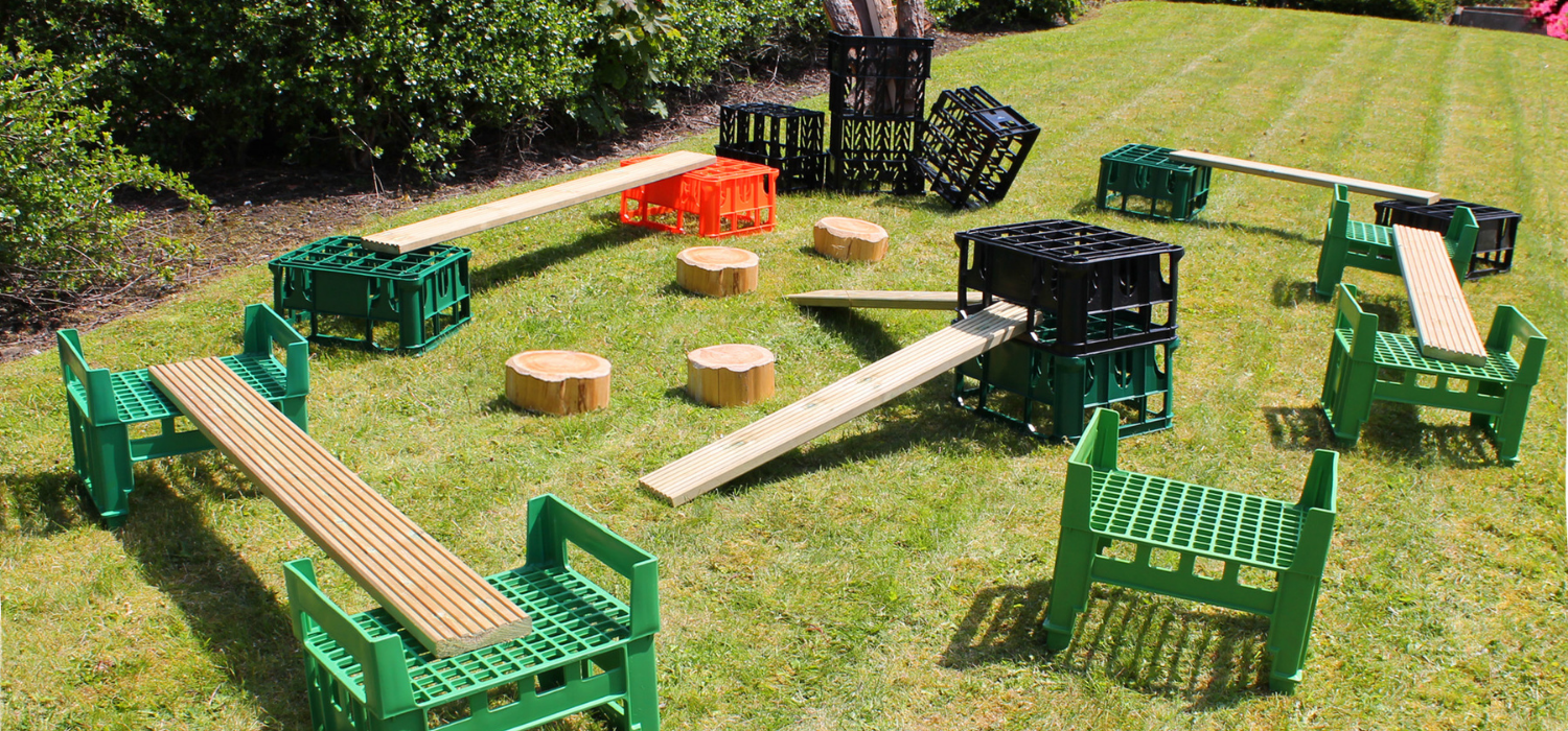 Obstacle course made from crates, planks and logs